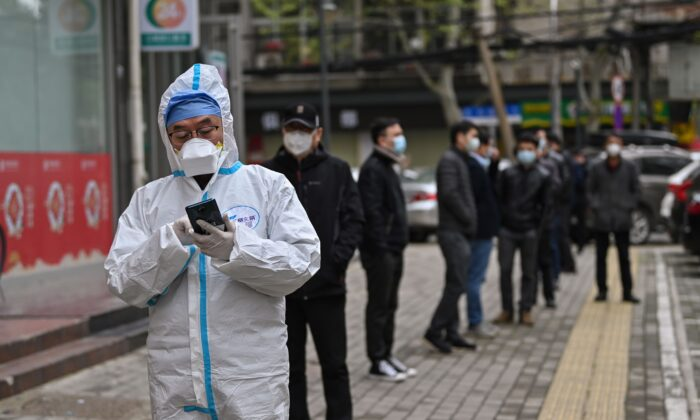 People wait to be tested for the CCP virus in Wuhan, China's central Hubei province on March 30, 2020. (Hector Retamal/AFP via Getty Images)