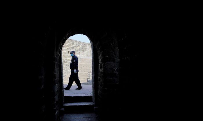A security guard wears a protective mask at the almost empty Badaling Great Wall in Beijing, China, on March 24, 2020. Affected by COVID-19, the Badaling Great Wall was closed on Jan. 25. (Lintao Zhang/Getty Images)