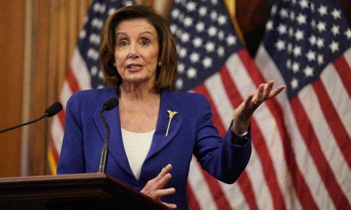 House Speaker Rep. Nancy Pelosi (D-Calif.) speaks to the press at the Capitol in Washington on March 27, 2020. (Alex Edelman/AFP via Getty Images)