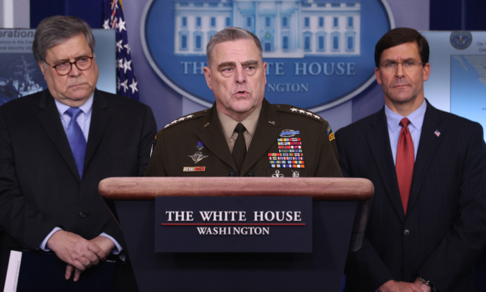 Chairman of the Joint Chiefs of Staff Gen. Mark Milley speaks about military operations during the daily White House coronavirus press briefing flanked by Attorney General William Barr (L) and Defense Secretary Mark Esper in Washington on April 1, 2020. (Win McNamee/Getty Images)