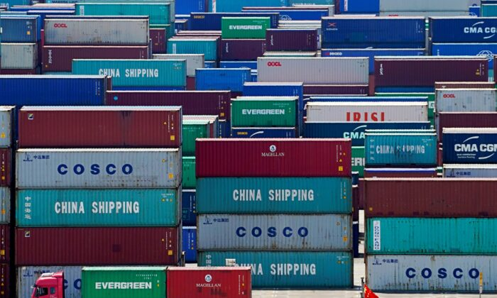Containers are seen at the Yangshan Deep Water Port in Shanghai, China, on Aug. 6, 2019. (Aly Song/Reuters)