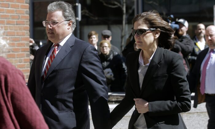Manuel and Elizabeth Henriquez arrive at federal court in Boston to face charges in a nationwide college admissions bribery scandal, in Boston on April 3, 2019. (Steven Senne/AP Photo/ File)
