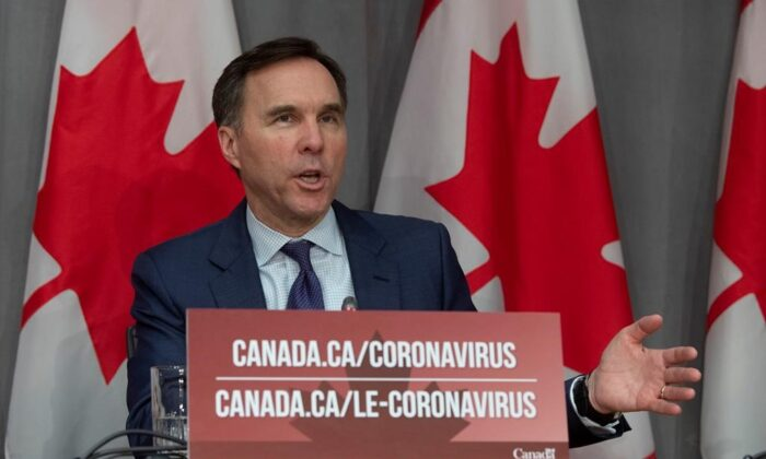 Minister of Finance Bill Morneau responds to a question during a news conference in Ottawa, March 27, 2020. Prime Minister Justin Trudeau says he's planning to call Parliament back for another sitting to pass more measures to help the Canadian economy through the COVID-19 pandemic. (Adrian Wyld/The Canadian Press)