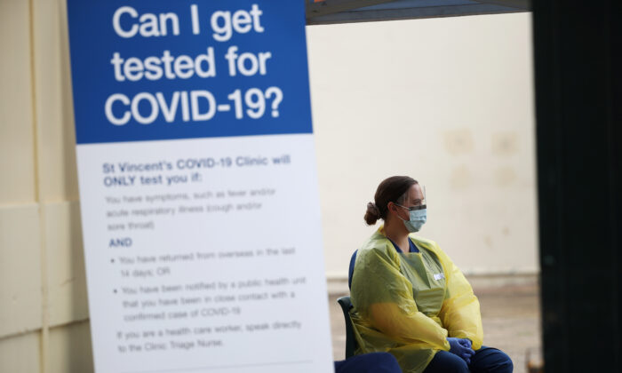 A healthcare professional waits at a pop-up clinic testing for the coronavirus disease (COVID-19) at Bondi Beach, after several outbreaks were recorded in the area, in Sydney, Australia April 1, 2020. (Loren Elliot/Reuters)