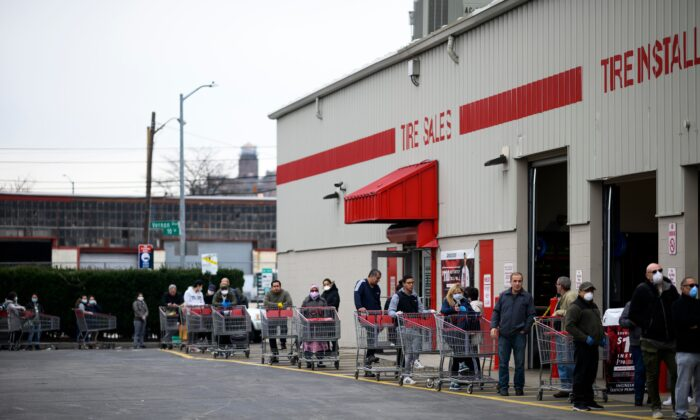 People keep social distance as they queue in front of a Costco wholesale market in Queens, New York City, on March 30, 2020. (Johannes Eisele/AFP via Getty Images)