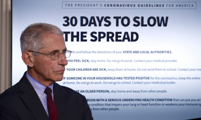 Dr. Anthony Fauci, director of the National Institute of Allergy and Infectious Diseases, listens as President Donald Trump speaks about COVID-19 at the White House, in Washington, on March 31, 2020. (Alex Brandon/AP Photo)