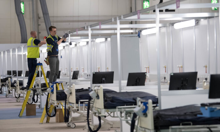 Work continues at ExCel London, during its conversion into the temporary NHS Nightingale Hospital, comprising of two wards, each of 2,000 people, to help tackle the CCP virus outbreak, in London on March 31, 2020. (Stefan Rousseau/Pool via Reuters)
