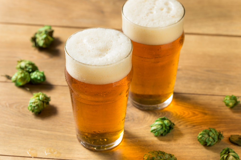 ipa beer in glass with hops