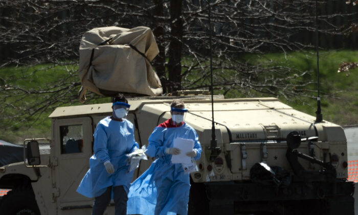 Healthcare professionals at a COVID-19 testing site organized by the Maryland National Guard in Landover, Maryland, on March 30, 2020. (Andrew Caballero-Reynolds/AFP/Getty Images)