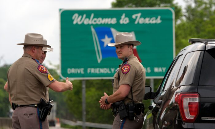 Texas State troopers patrol I-10 in Orange, Tex. across the border from Louisiana on March 30, 2020. (Mark Feli/AFP via Getty Images)