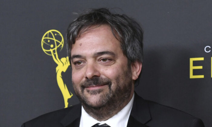 """Adam Schlesinger, winner of the awards for outstanding original music and lyrics for """"Crazy Ex Girlfriend,"""" in the press room at the Creative Arts Emmy Awards in Los Angeles on Sept. 14, 2019. (Richard Shotwell/Invision/AP, File)"""