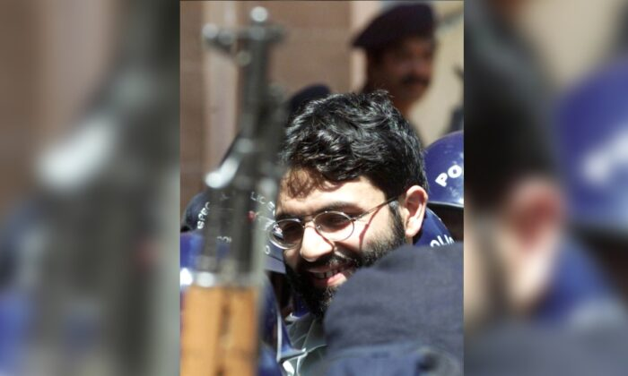 British-born Islamic terrorist Ahmed Omar Saeed Sheikh is surrounded by armed police as he arrives at a court in Karachi, Pakistan, on March 29, 2002. (Zahid Hussein/File Photo/Reuters)