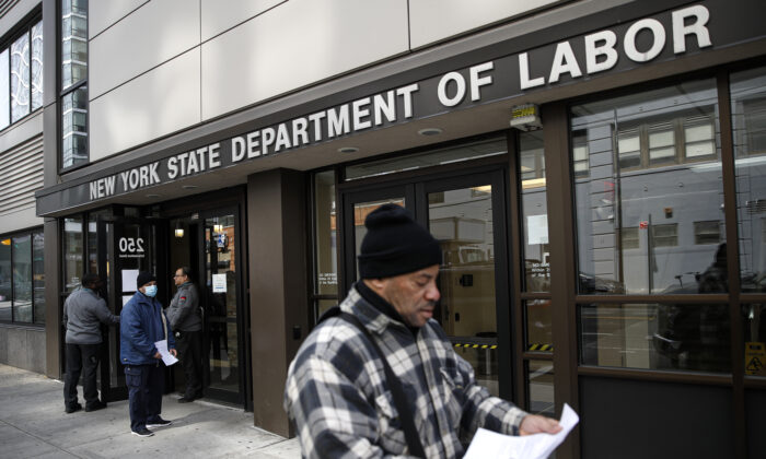 Visitors to the New York State Department of Labor are turned away at the door by personnel, due to closures over CCP virus concerns in New York City, N.Y., on March 18, 2020. (John Minchillo/AP Photo)