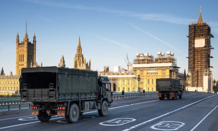 Military vehicles cross Westminster Bridge after members of the 101 Logistic Brigade of the British Army delivered a consignment of medical masks to St Thomas' hospital in London, England, on March 24, 2020. (Leon Neal/Getty Images)