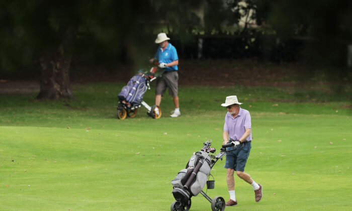 Golfers walk across the course at Woollahra Golf Club in Sydney, Australia, where golf is still allowed amid COVID-19 preventative measures, on April 2, 2020. (Matt King/Getty Images)