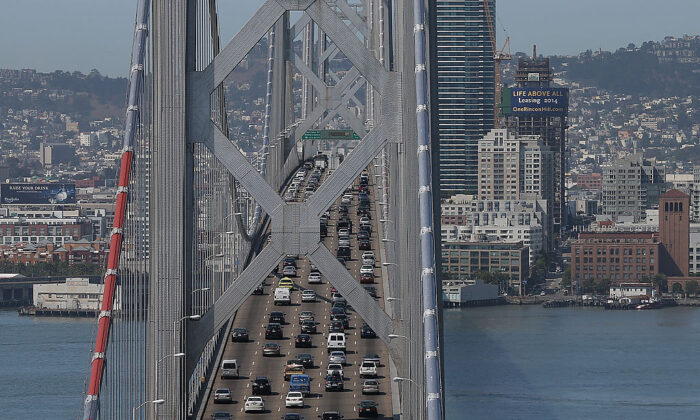 Commuter traffic moves across the western span of the San Francisco-Oakland Bay Bridge on July 1, 2013. (Justin Sullivan/Getty Images)