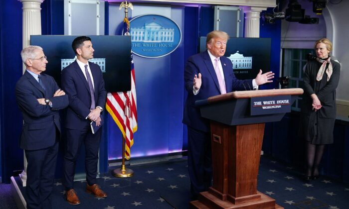 President Donald Trump gestures as he speaks during the daily briefing on the CCP virus, in the Brady Briefing Room at the White House on April 1, 2020, in Washington. (Mandel Ngan/AFP via Getty Images)