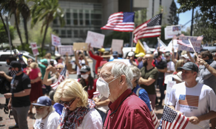 Demonstrators protest during a rally to re-open California and against Stay-At-Home directives in San Diego, Calif., on May 1, 2020. (Sandy Huffaker/AFP via Getty Images)