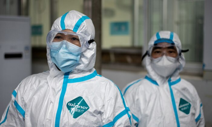 Medical workers wearing hazmat suits as a preventive measure against the COVID-19 coronavirus are seen at a fever clinic in Huanggang Zhongxin Hospital in Huanggang, in Chinas central Hubei province on March 26, 2020. (Noel Celis/AFP via Getty Images)
