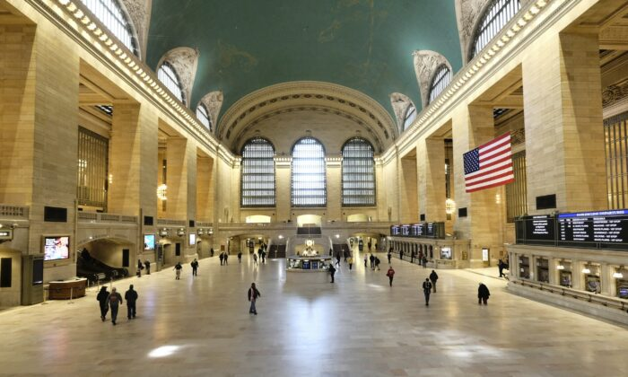 A sparsely occupied Grand Central Station appears at midday in New York City on March 18, 2020. (Evan Agostini/Invision/AP)