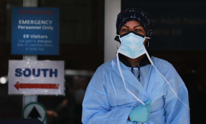 Medical workers wait for patients at a special coronavirus intake area at Maimonides Medical Center in the Brooklyn borough of New York City on April 2, 2020. (Spencer Platt/Getty Images)