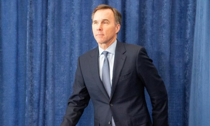 Federal Finance Minister Bill Morneau arrives for a news conference in Toronto on April 1, 2020. (Frank Gunn/The Canadian Press)