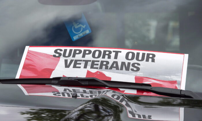 A sign is placed on a truck windshield, in a file photo, as members of the advocacy group Banished Veterans protest outside the Veterans Affairs office in Halifax. (Andrew Vaughan/The Canadian Press)