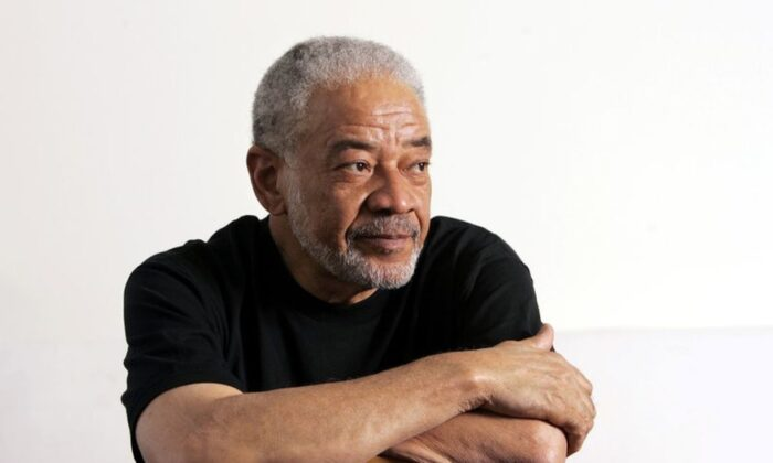 "Singer-songwriter Bill Withers poses in his office in Beverly Hills, Calif. on June 21, 2006. Withers, who wrote and sang a string of soulful songs in the 1970s that have stood the test of time, including ""Lean On Me,"" ""Lovely Day"" and ""Ain't No Sunshine,"" died in Los Angeles from heart complications on Monday, March 30, 2020. He was 81. (Reed Saxon/AP Photo)"