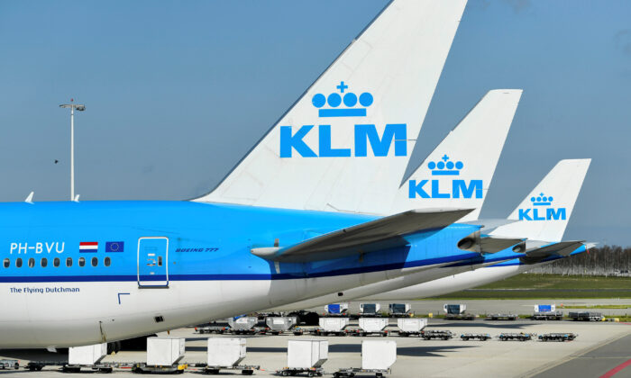 KLM airline airplanes are seen parked, as Schiphol Airport reduces its flights due to the CCP virus disease (COVID-19) outbreak, in Amsterdam, Netherlands, on April 2, 2020. (Piroschka van de Wouw/Reuters)