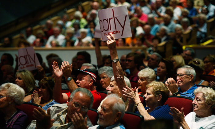 Residents of Laguna Woods Village retirement community, who live close to a hotel that will be used to house transient COVID-19 patients, cheer during a campaign event in Laguna Woods, Calif., on Oct. 28, 2010. (Kevork Djansezian/Getty Images)