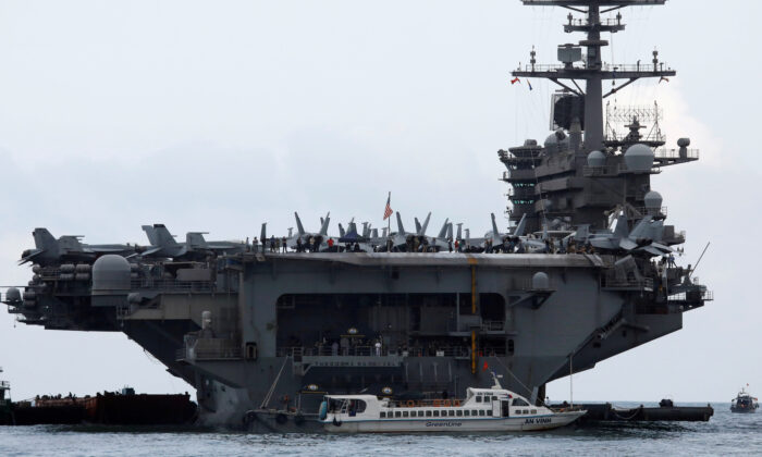 The USS Theodore Roosevelt (CVN-71) is seen while entering into the port in Da Nang, Vietnam, on March 5, 2020. (Kham/File Photo/Reuters)