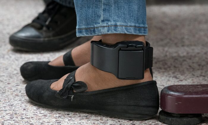 An ankle monitor in a file photograph. (Loren Elliott/AFP via Getty Images)