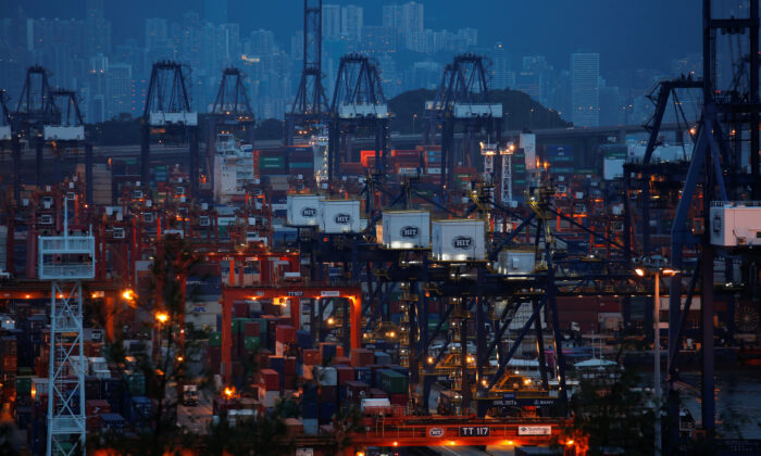 A general view of Hongkong International Terminals (HIT), owned by Hutchison Port Holdings, as part of the Kwai Tsing Container Terminals for transporting shipping containers in Hong Kong, China, on July 25, 2018. (Bobby Yip/Reuters)