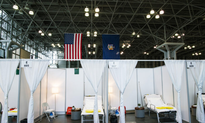 Hospital bed booths are set up at the Jacob K. Javits Convention Center which is being turned into a hospital to help fight COVID-19 cases in New York City on March 27, 2020. (Eduardo Munoz Alvarez/Getty Images)