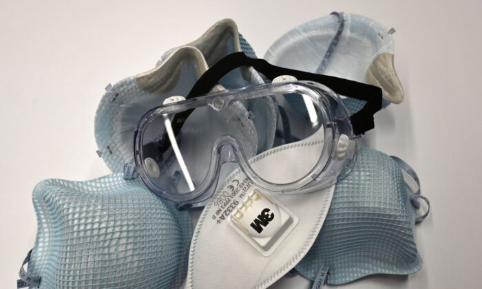 Protective N95 masks lie on a table at an office in Washington on Feb. 26, 2020. (Eva Hambach/AFP/Getty Images)