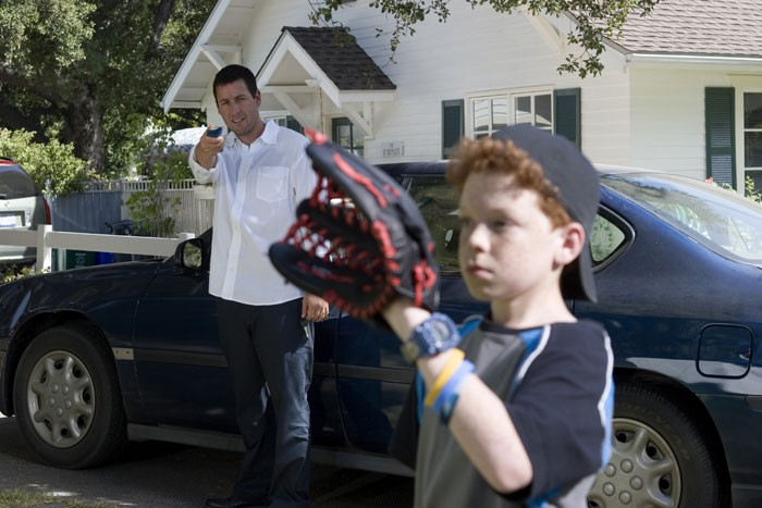 """man with tv remote, boy with baseball glove in """"Click."""""""