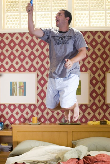 """man jumps on bed with tv remote in """"Click."""""""