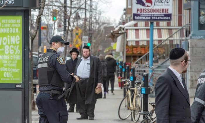 Police keep an eye on social distancing in Montreal, Canada, on April 3, 2020. (Ryan Remiorz/The Canadian Press)