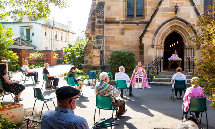 Father James Collins holds a service in the yard of St Paul's Anglican Church in Burwood with seating observant of social distancing on March 22, 2020 in Sydney, Australia.  (Jenny Evans/Getty Images)
