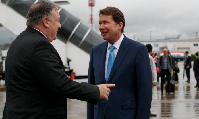 Secretary of State Mike Pompeo (L) talks with then-US Ambassador to Japan Bill Hagerty as he arrives in Osaka on June 27, 2019. (Jacquelyn Martin/AFP via Getty Images)