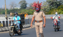 Indian Police Officer Dons 'CCP Virus Helmet' to Warn Motorists to Stay Home