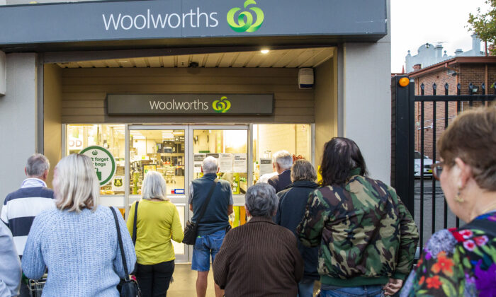 Customers wait outside a Woolworths supermarket on in Sydney, Australia, March 17, 2020. (Jenny Evans/Getty Images)