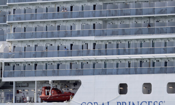 People look out from the Coral Princess cruise ship as it is docked at PortMiami during the CCP virus outbreak, in Miami, Florida, on April 4, 2020. (Lynne Sladky/AP)