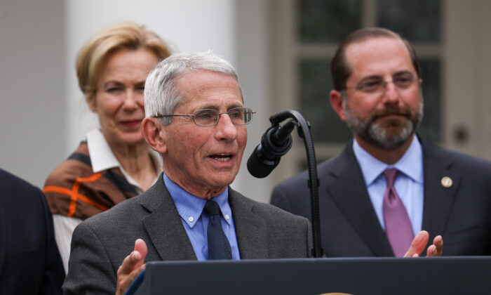 Director of the National Institute of Allergy and Infectious Diseases Anthony Fauci, flanked by officials and business leaders, speaks to media after President Donald Trump announced a national emergency with regard to the coronavirus in the White House Rose Garden in Washington on March 13, 2020. (Charlotte Cuthbertson/The Epoch Times)