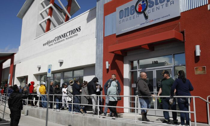 People wait in line for help with unemployment benefits at the One-Stop Career Center in Las Vegas, Nev., on March 17, 2020. (John Locher/AP Photo)