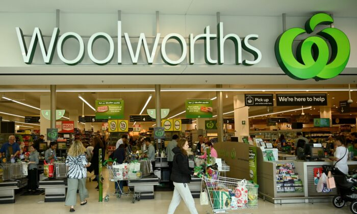 People shop at a Woolworths supermarket in Sydney on March 17, 2020. (Peter Parks/AFP via Getty Images)