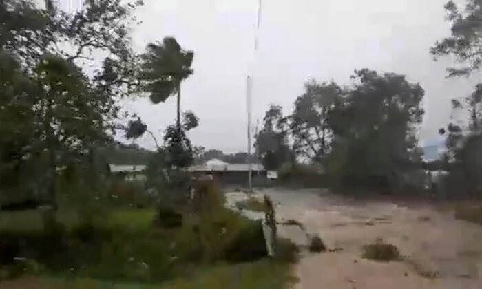 Cyclone Harold brings strong winds in Luganville, Vanuatu on April 6, 2020, in this still image obtained from a social media video. (Courtesy of Adra Vanuatu/Social Media via Reuters)