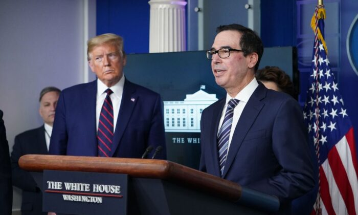 Secretary of the Treasury Steve Mnuchin speaks while President Donald Trump listens during the daily briefing on COVID-19 in the Brady Briefing Room at the White House in Washington on April 2, 2020. (Mandel Ngan/AFP via Getty Images)