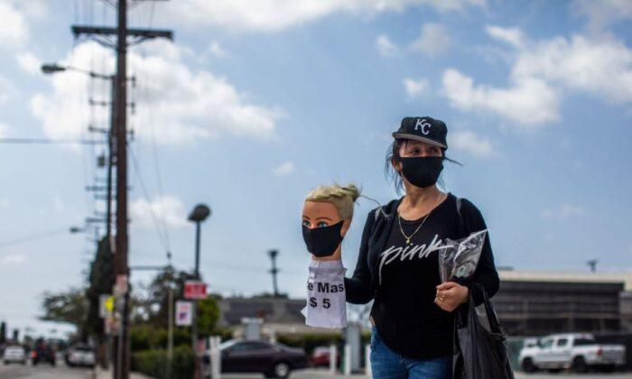 Dressmaker Flor Hernandez sells face masks on street after losing her job during the novel coronavirus (COVID-19) outbreak in Los Angeles, California on April 2, 2020. (APU GOMES/AFP via Getty Images)