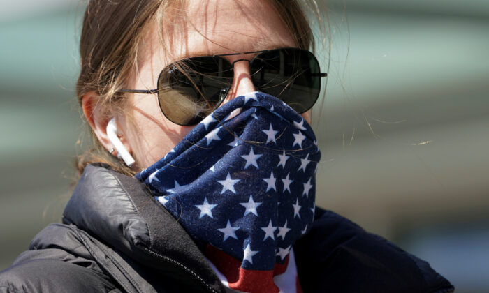 A woman wears a stars and stripes bandana for a mask, amid COVID-19 fears, in Washington on April 2, 2020. (Kevin Lamarque/Reuters)